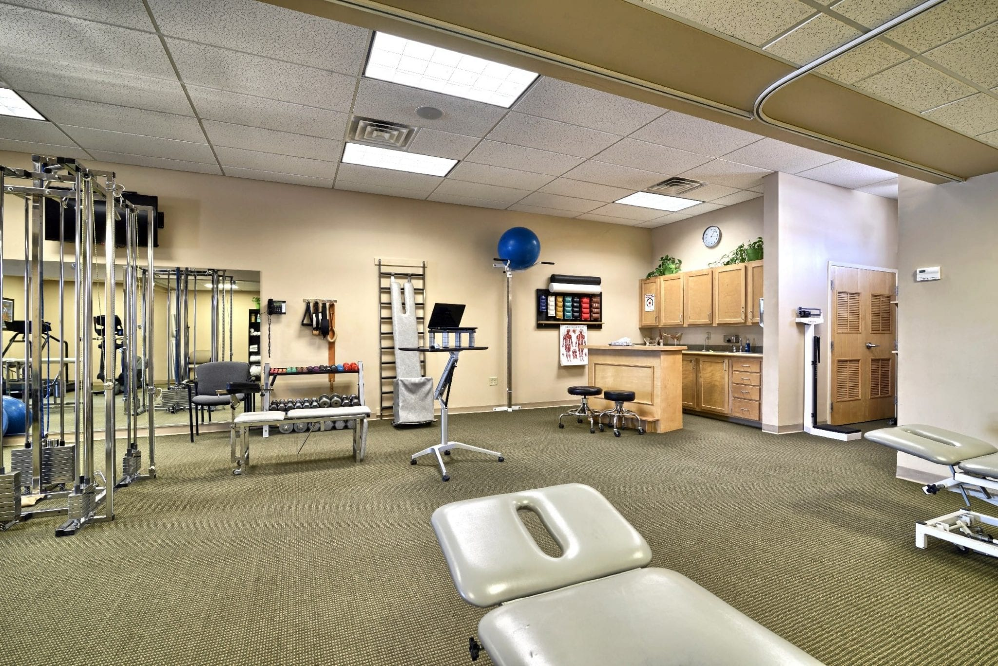 An image of stretch beds, bands, and other equipment at our physical therapy clinic in Epping, New Hampshire.