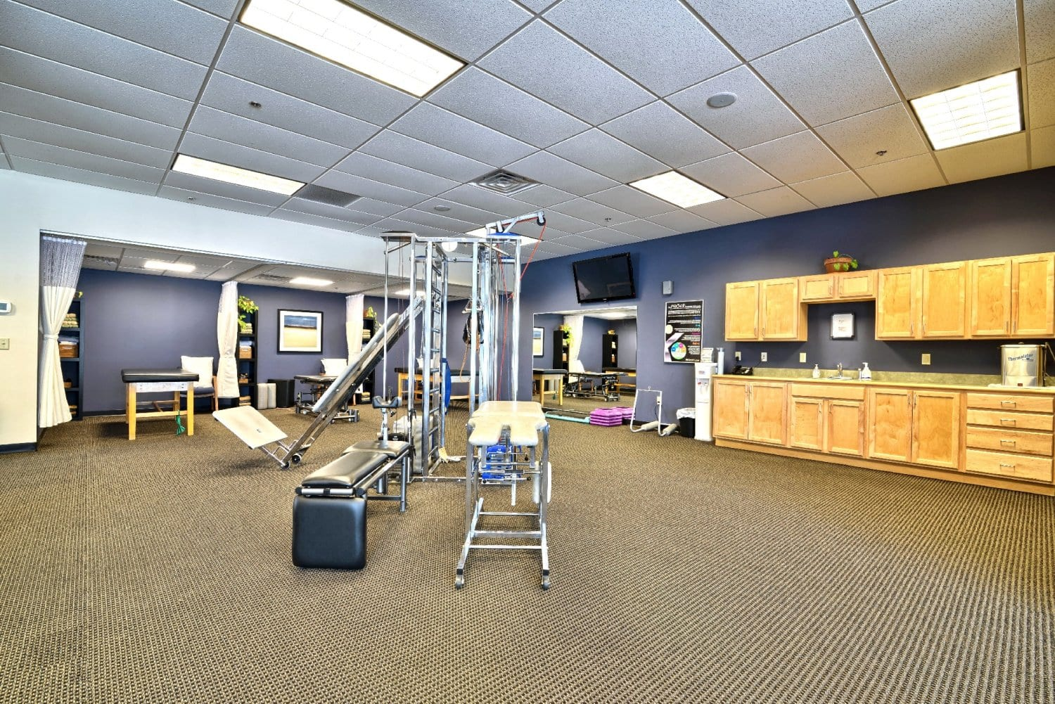 An image of the interior of our physical therapy clinic in Somersworth, New Hampshire. This image showcases a clean facility and equipment.