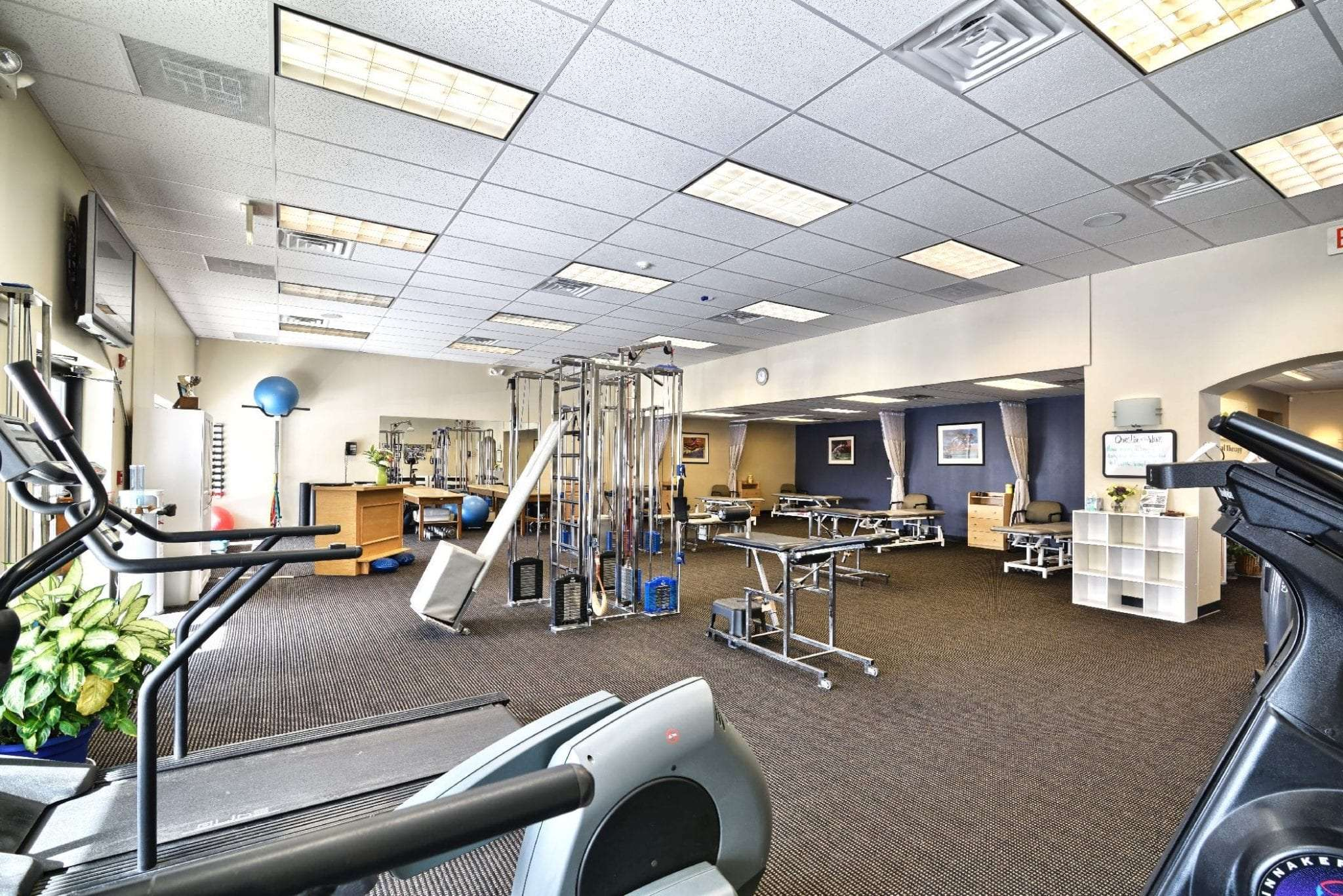 Here is a photo of the interior of our Physical Therapy Clinic in Stratham, New Hampshire. This image shows our clean facility and equipment