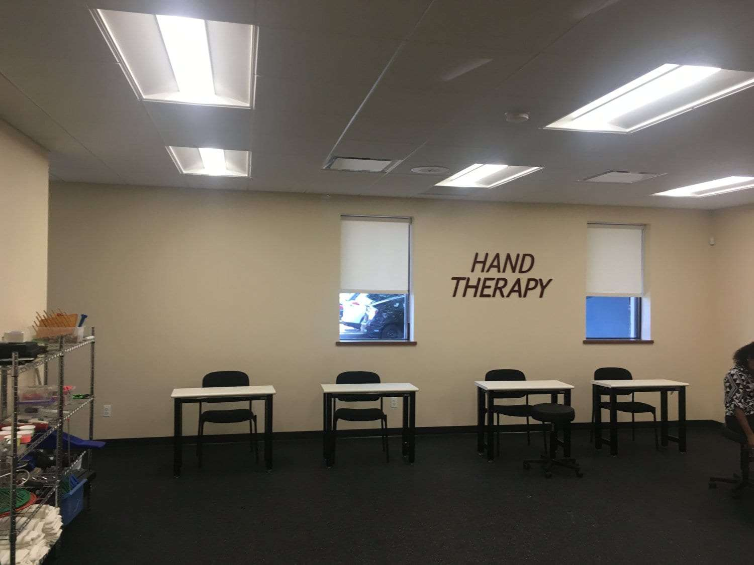 An image of four stations where patients will sit at for hand therapy in our physical therapy clinic in Hewlett, New York.