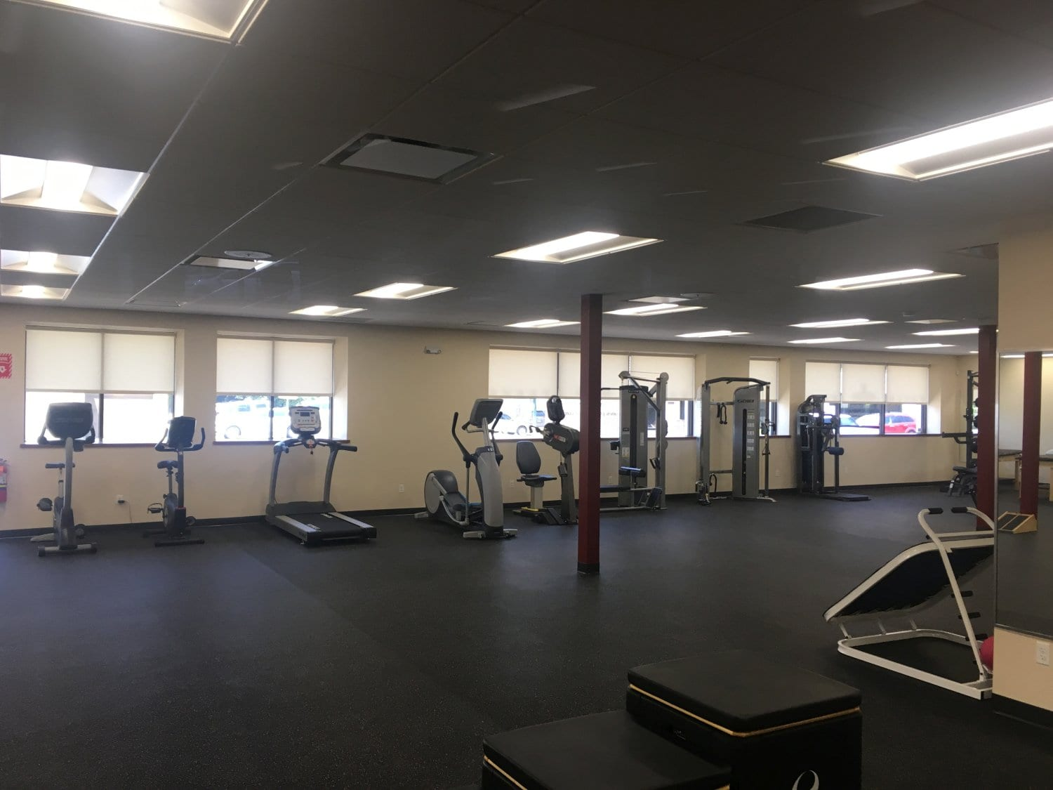 An image of our large training room at our physical therapy clinic in Hewlett, New York. This image shows machines like the elliptical and treadmill which are great for increasing mobility.