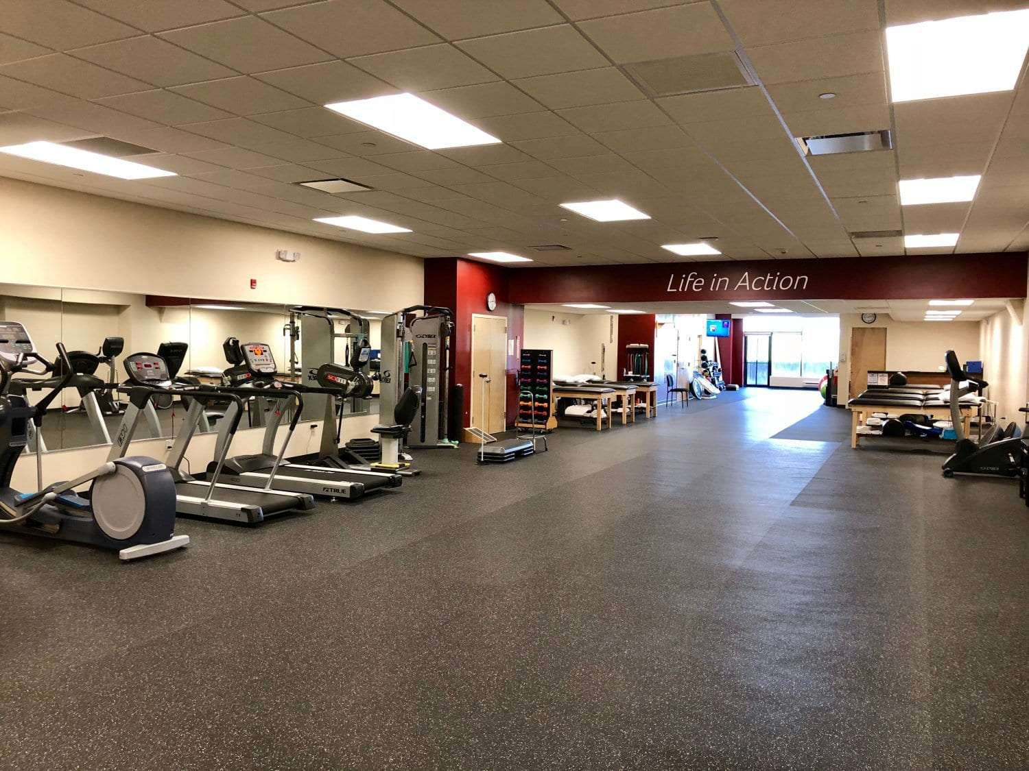 Here is another angle of our training area in our physical therapy clinic in Morristown, New Jersey at Headquarters Plaza. Photo includes treadmills, wall mirror, and stretch beds.
