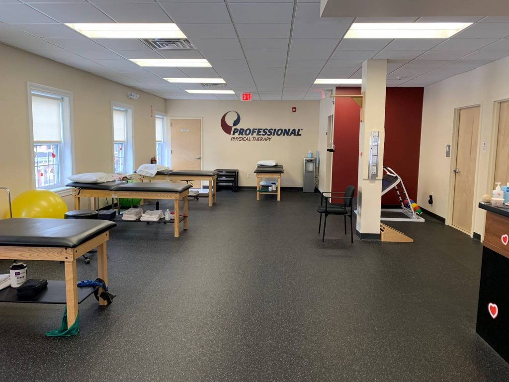 Image of the interior of our physical therapy clinic in Westfield, NJ with Pro PT logo on wall.
