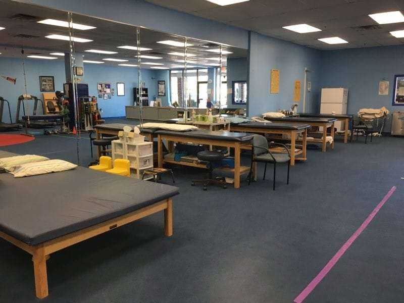 An image of the main rehabilitation room and exercise beds at our physical therapy clinic in Tyngsborough, MA.