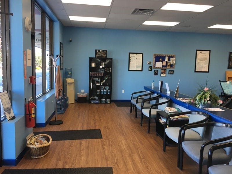 Waiting room and reception at our Tyngsborough, MA professional physical therapy clinic.
