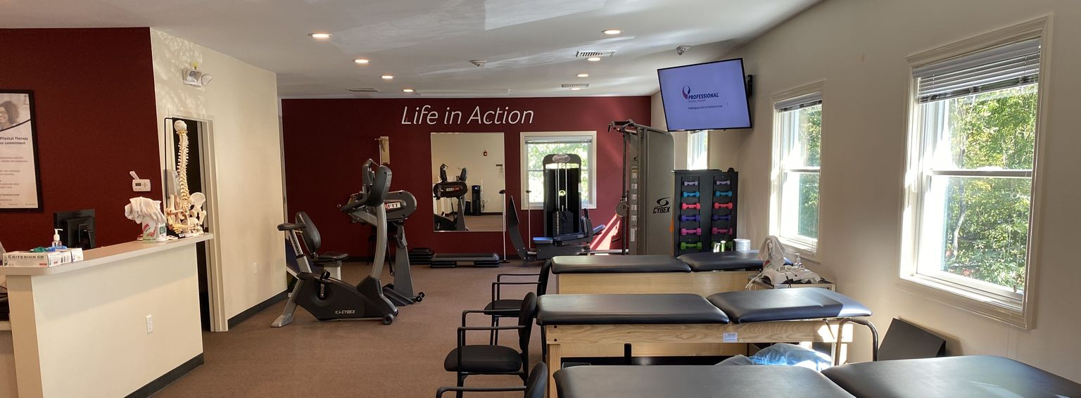 Wide view of reception and rehab room in our Montville, NJ physical therapy and sports medicine clinic.