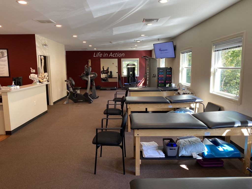 Exercise equipment and medical beds at our Montville, NJ physical therapy clinic.