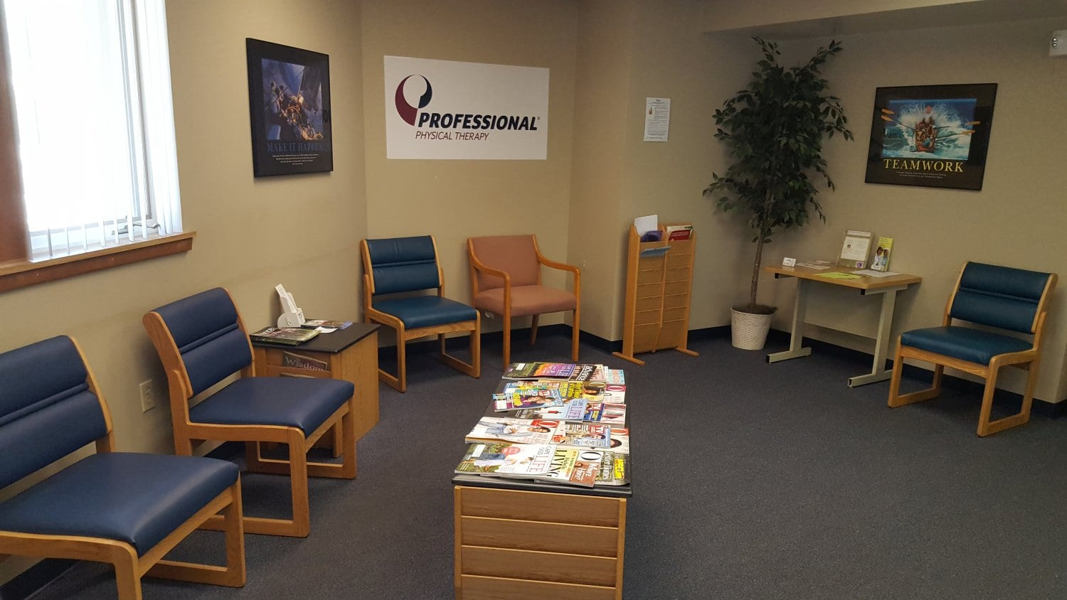 A photo of the waiting area at our physical therapy clinic in Marshfield, Massachusetts. There is a motivational sign for teamwork on the wall.