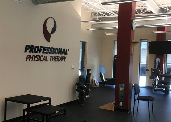 Interior of our physical therapy and sports medicine clinic in Princeton, NJ with our logo on the wall in the main rehabilitation room.