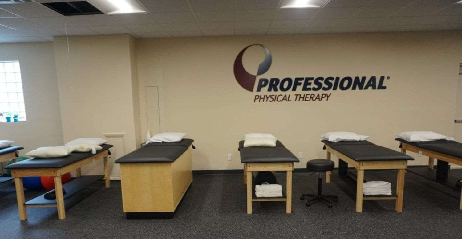 This is a photo of five stretch beds along a wall at our facility. There is a sign for professional physical therapy on the wall at our clinic in Long Beach, New York.
