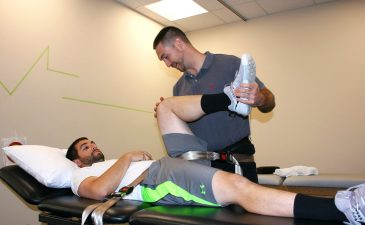 Physical Therapist at a clinic in NY performing injury prevention and physical therapy stretching