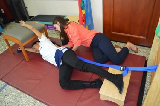 A Physical Therapist at a NYC clinic performing Schroth Method physical therapy.
