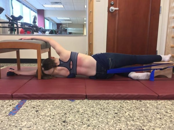 Schroth method stretching at a physical therapy clinic in New York for scoliosis treatment.