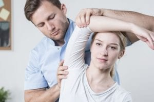 orthopedic physical therapy shoulder stretching at a manhattan clinic.