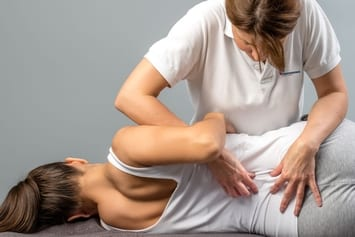 Womens physical therapy on lower back and spine.