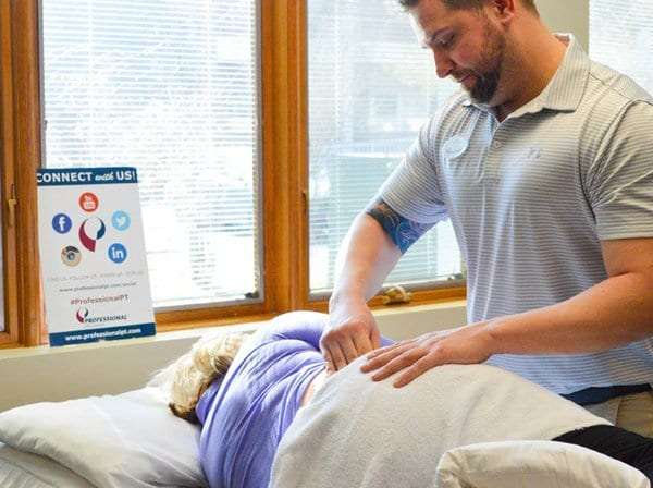 Professional physical therapist in Manhattan performing hip pain treatment techniques.