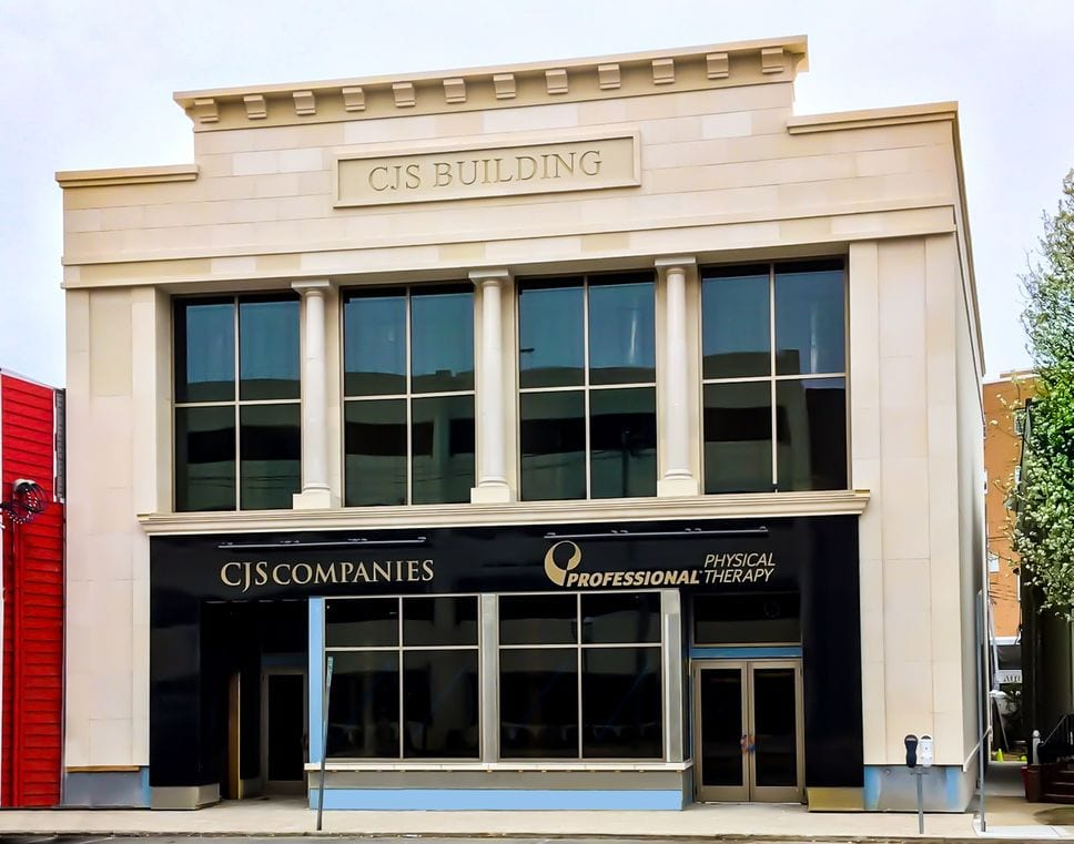 Exterior of our physical therapy clinic in Red Bank, NJ with the front of the CJS Building.