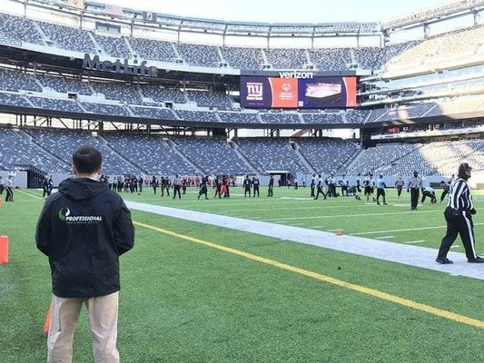 Professional physical therapists on a football field for athletic training in NYC