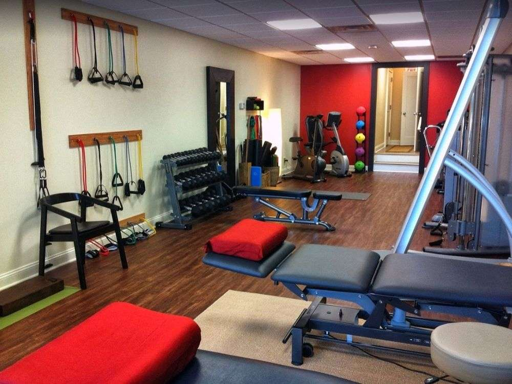 Interior therapy room with red wall and rehabilitation equipment at our physical therapy clinic in Madison, NJ.