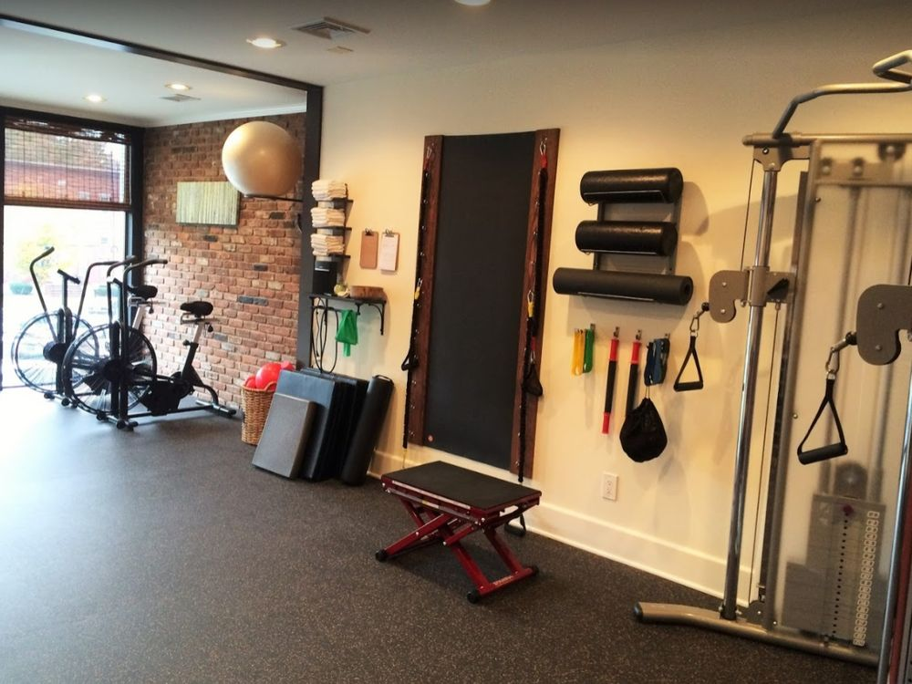 Rehabilitation machines and bikes inside our Madison, NJ physical therapy clinic.