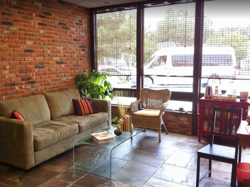 Waiting room with couch and windows at our Madison, NJ physical therapy clinic.
