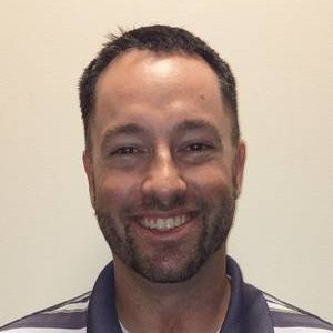 Headshot of clinic director and physical therapist Chris Costello.